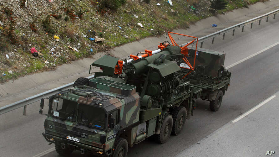 FILE - German military trucks carrying NATO's Patriot Missile Defense leave the port in the Mediterranean city of Iskenderun, Turkey, Jan. 22, 2013.