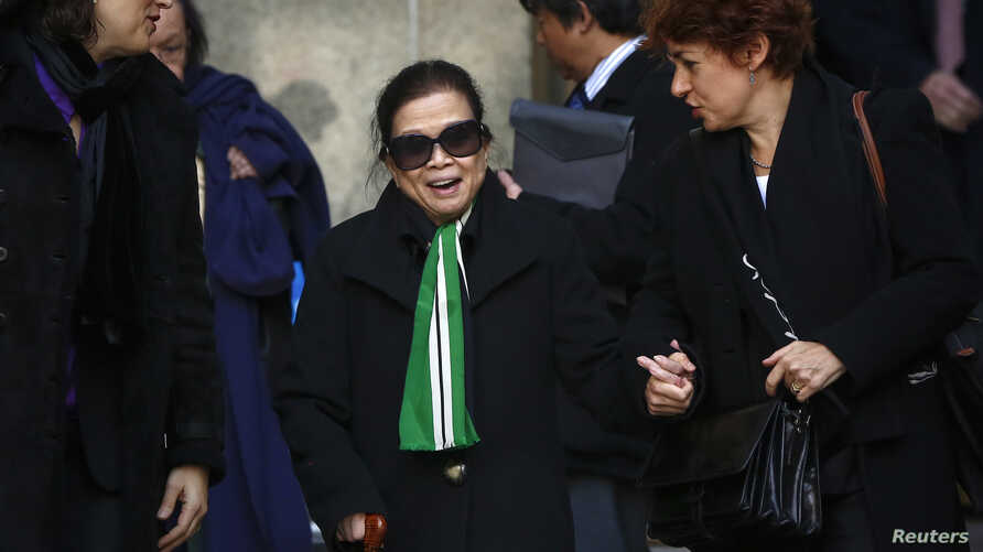 Vilma Bautista (C), the ex-secretary of former Philippine first lady Imelda Marcos, smiles after her sentencing at the Manhattan Supreme Court  in New York, Jan. 13, 2014.