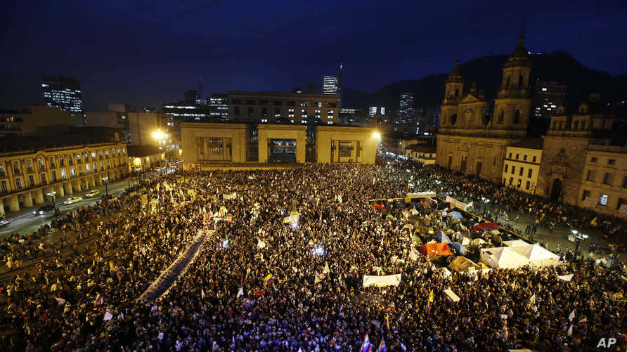 People gather at Bolivar's square during a peace march in Bogota, Colombia, Oct. 12, 2016. Thousands of rural farmers, indigenous activists and students marched in cities across Colombia to demand a peace deal between the government an leftist rebels