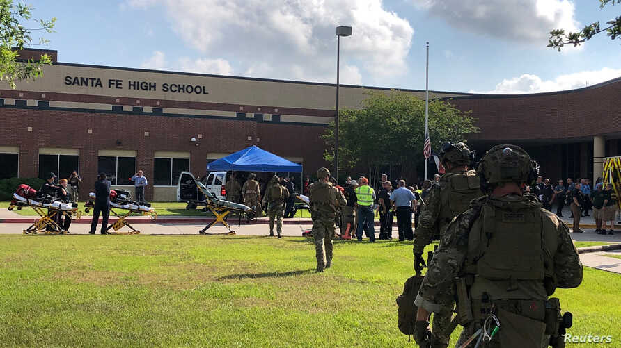 Law enforcement officers respond to Santa Fe High School following a shooting incident in this Harris County Sheriff office, Santa Fe, Texas, photo released on May 18, 2018.