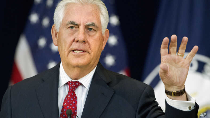 FILE - Secretary of State Rex Tillerson gestures while speaking to State Department employees.