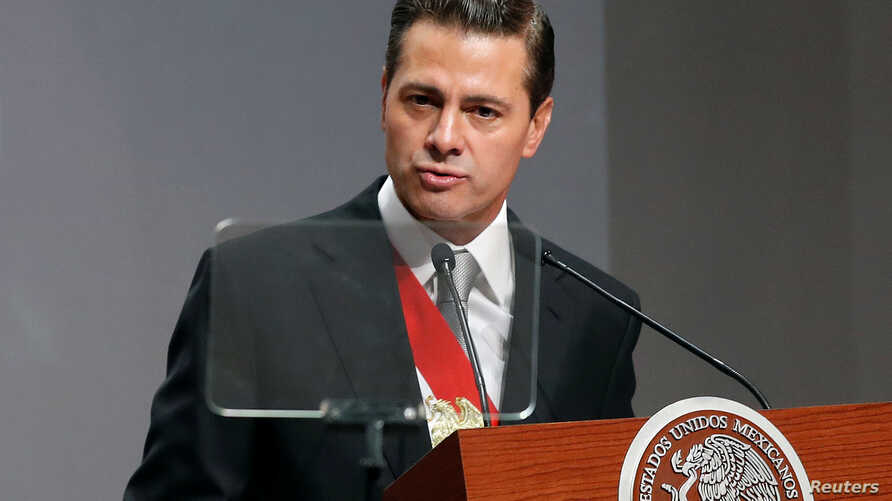 Mexico's President Enrique Pena Nieto delivers his sixth and last State of the Union address at the National Palace in Mexico City, Mexico, Sept. 3, 2018.