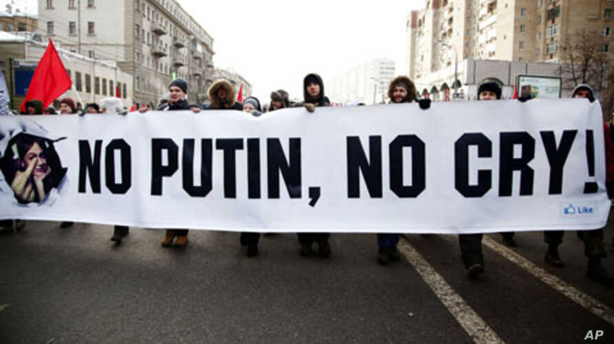 Protesters walk with anti-Putin banner in mass opposition march in central Moscow, Feb. 4, 2012.