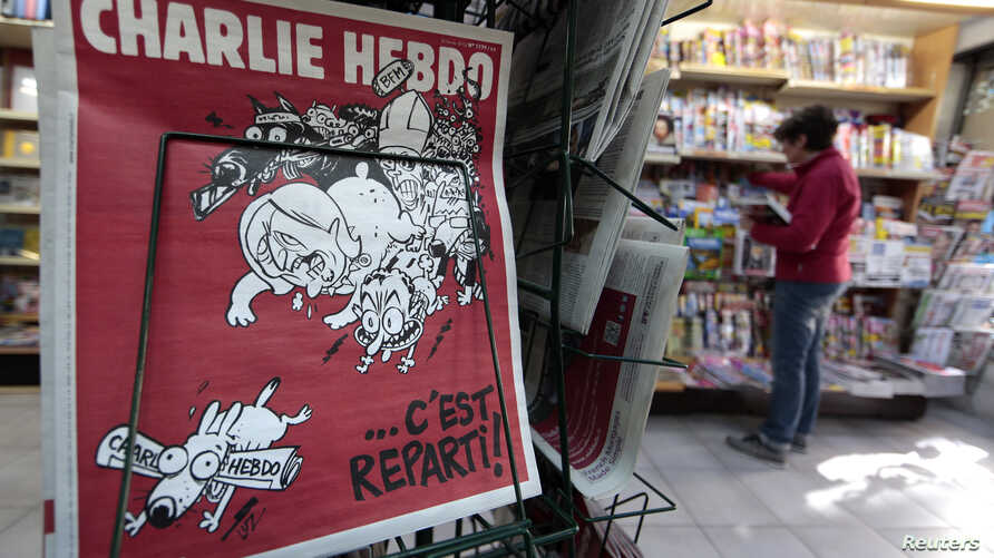 "The front page of the new issue of satirical French weekly Charlie Hebdo entitled ""C'est Reparti"" (""Here we go again""),  is displayed at a kiosk in Nice, Feb. 25, 2015."