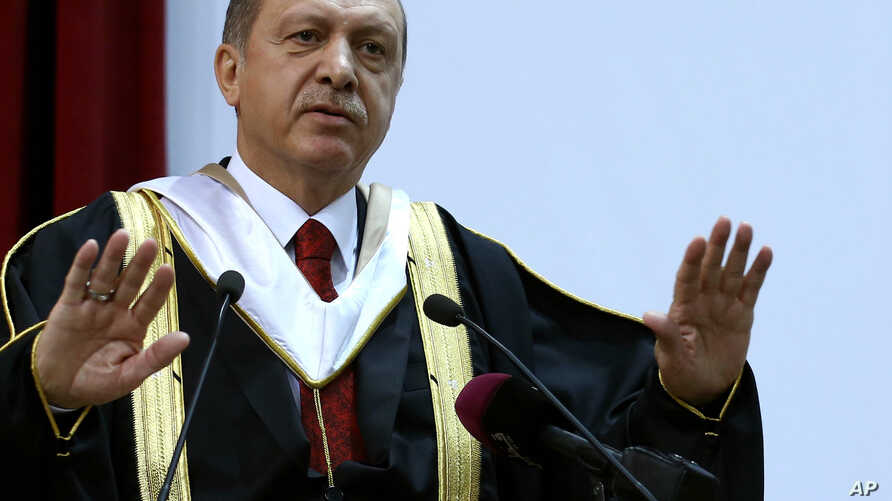 Turkey's President Recep Tayyip Erdogan addresses an audience after receiving an honorary doctorate from Qatar University, in Doha, Qatar, Dec. 2, 2015.