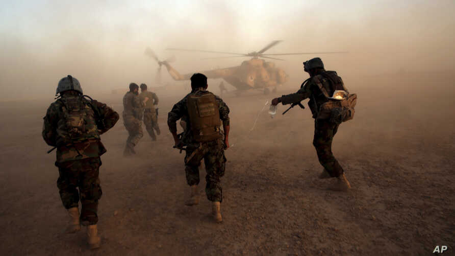 Afghan army commandos train at the Shorab military base in Helmand province, Afghanistan, Aug. 27, 2017. The Taliban attacked the base Friday in a pre-dawn assault.