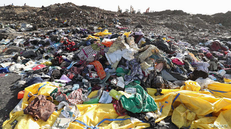 Clothing and personal effects from passengers are seen near the wreckage at the scene of the Ethiopian Airlines Flight ET 302 plane crash, near the town of Bishoftu, southeast of Addis Ababa, March 11, 2019.