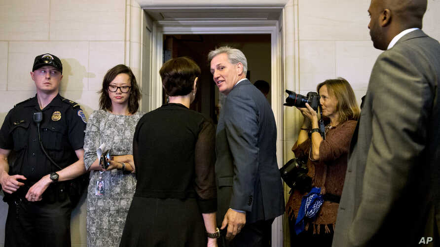 California congressman Kevin McCarthy, center, turns to his wife Judy McCarthy as they enter a House Republican caucus vote on its nominee to replace House Speaker John Boehner, on Capitol Hill in Washington, Oct. 8, 2015.