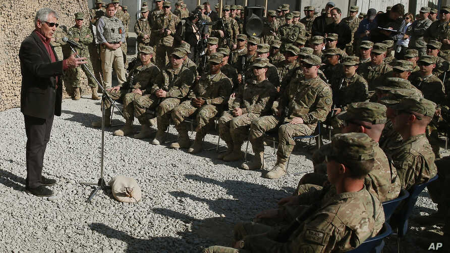 U.S. Defense Secretary Chuck Hagel speaks to American troops near Jalalabad during a visit to Afghanistan Dec. 7, 2014.