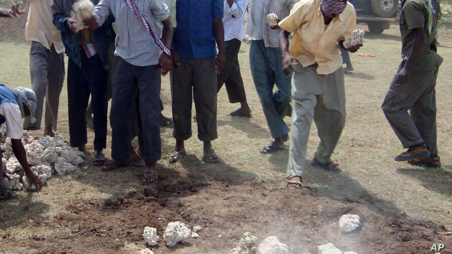 FILE - The site of an execution by stoning is seen in Afgoye district, Somalia, Dec. 13, 2009. The al-Shabab militant group allegedly stoned to death a 44-year-old man in Rama Addey town in southern Somalia's Bay region, having found him guilty of ad