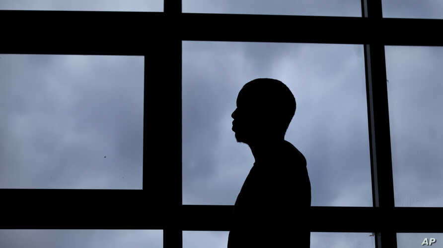 A 26-year-old gay Ugandan man, who insisted on anonymity because of fears for his safety, speaks to The Associated Press, in Nairobi, Kenya, Aug. 7, 2014.