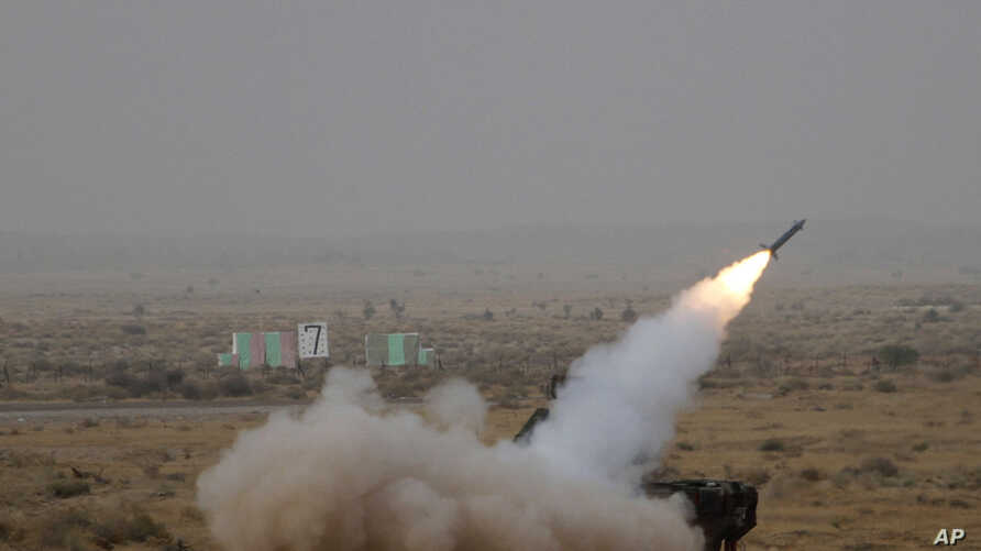 FILE - A surface to air missile is launched during exercise 'Iron Fist' at Pokhran, India, March 18, 2016.
