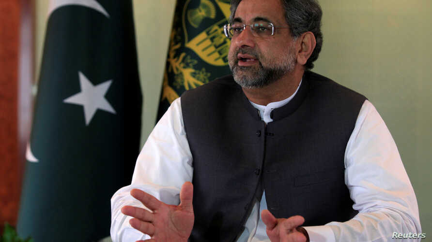 Pakistan's Prime Minister Shahid Khaqan Abbasi speaks with a Reuters correspondent during an interview at his office in Islamabad, Pakistan, Sept. 11, 2017.
