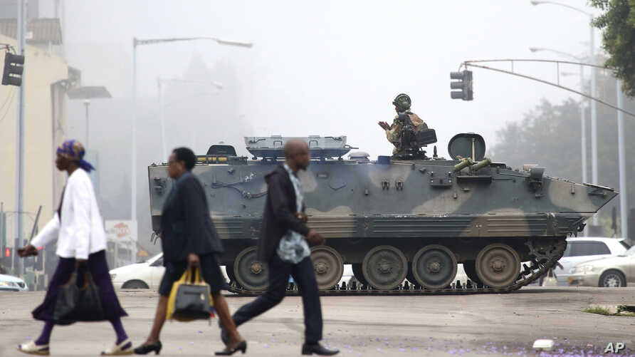 An armed soldier patrols a street in Harare, Zimbabwe, Nov. 15, 2017.
