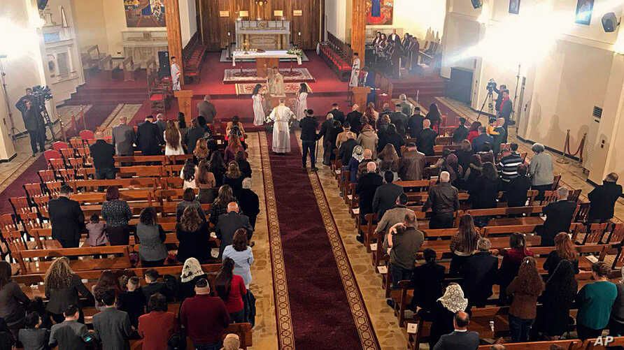 Iraqis attend Christmas Mass at Mar Youssif Chaldean Church, in Baghdad, Dec. 25, 2018.