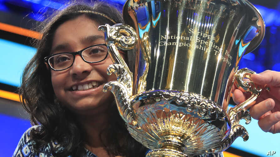 Ananya Vinay, 12, from Fresno, Calif., holds the trophy after winning the 90th Scripps National Spelling Bee, in Oxon Hill, Md., June 1, 2017.