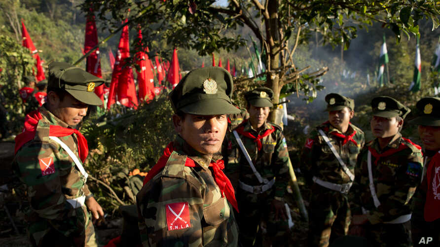 FILE -  officers with the Ta'ang National Liberation Army gather in the steep hillside jungles in Mar Wong, a village in northern Shan state, Myanmar.