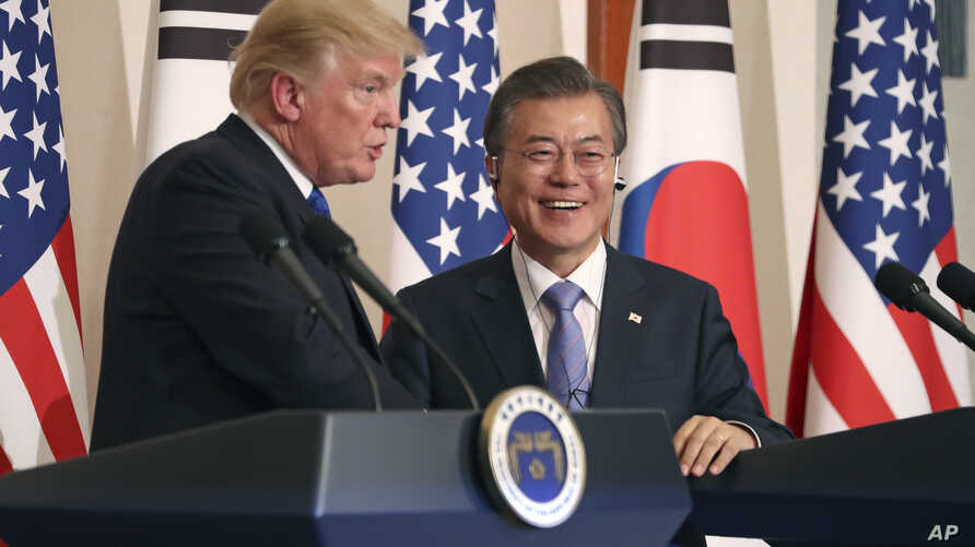 President Donald Trump, left, speaks as South Korean President Moon Jae-in looks on during a joint news conference at the Blue House in Seoul, South Korea, Tuesday, Nov. 7, 2017.