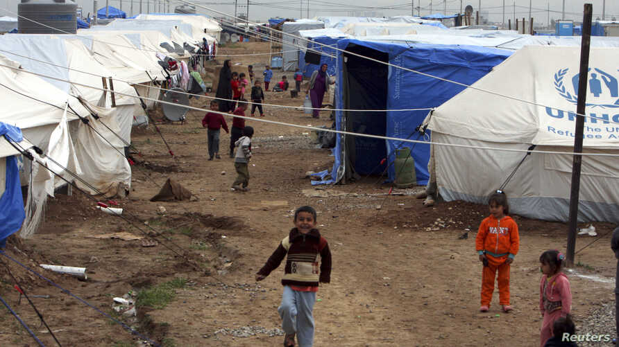 Displaced Iraqi children, who fled from Islamic State violence in Mosul, play in a refugee camp on the outskirts of the Kurdish city of Erbil, Dec. 1, 2014.
