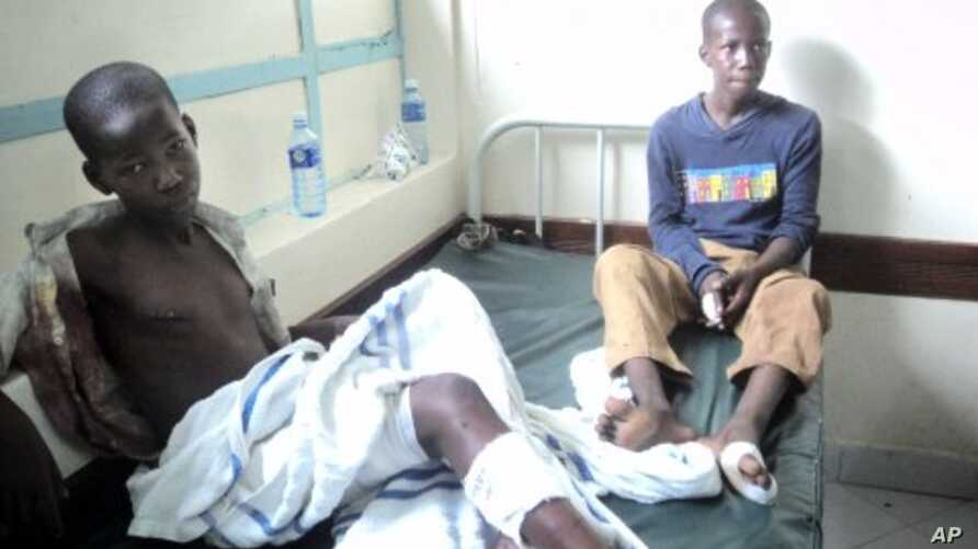 Two children who survived a grenade attack by suspected al-Shabab members on a church are seen in a hospital in Garissa, Kenya, November. 6, 2011.
