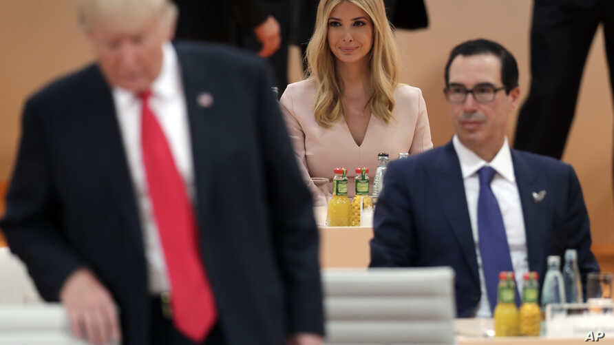 FILE - Ivanka Trump, daughter of U.S. President Donald Trump, left, attends a working session at the G-20 summit in Hamburg, northern Germany, July 8, 2017. Earlier this month, President Donald Trump left his chair at the G20 summit while Africa was