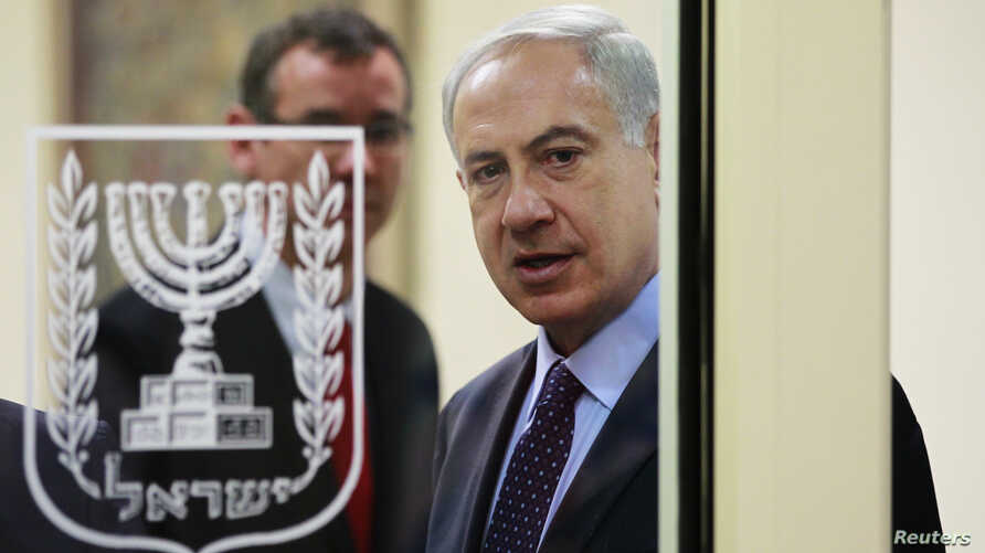 Israeli Prime Minister Benjamin Netanyahu is seen through a glass door as he arrives to deliver joint statements with Czech Republic's President Milos Zeman (not pictured) in Jerusalem October 7, 2013. Zeman began on Monday his three-day visit to Isr