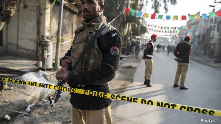 A policemen cordons off the site of a suicide blast in Rawalpini, Jan. 20, 2014.
