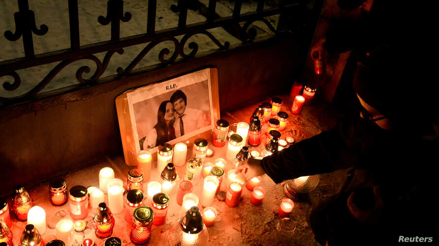 People light candles in front of Slovakia's government building during a march in memory of murdered Slovak investigative reporter Jan Kuciak and his girlfriend Martina Kusnirova, in Bratislava, Slovakia, March 2, 2018.