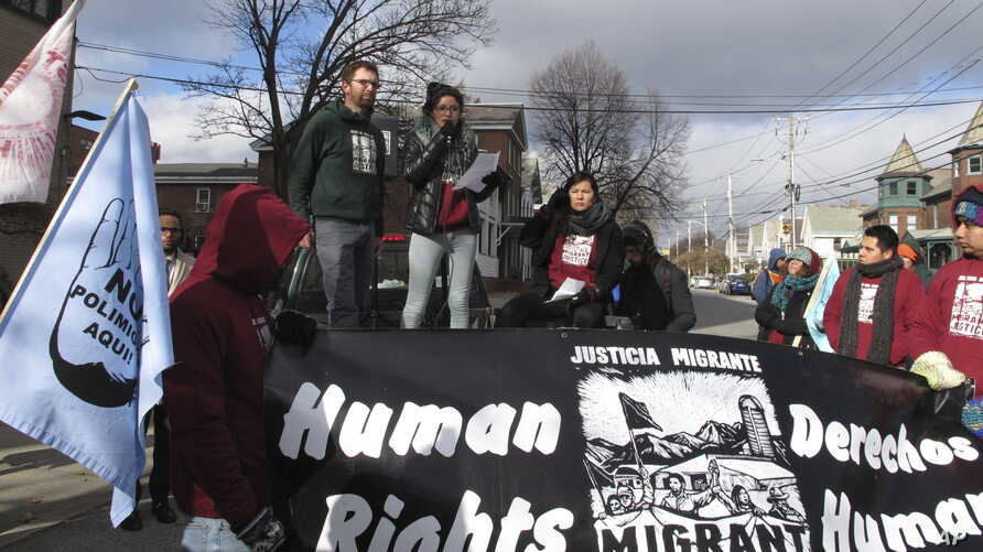 Zully Palacios Rodriguez, a member of the immigrant advocacy group Migrant Justice, speaks to a crowd outside the federal court in Burlington, Vt., Nov. 14, 2018.