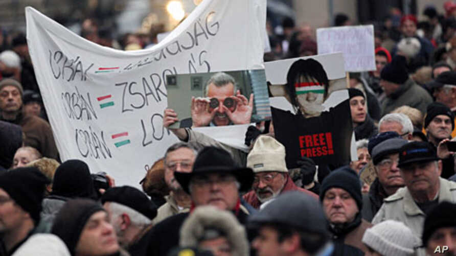 Thousands of protesters demonstrate against the Hungarian government in front of the parliament building in Budapest, December 23, 2011