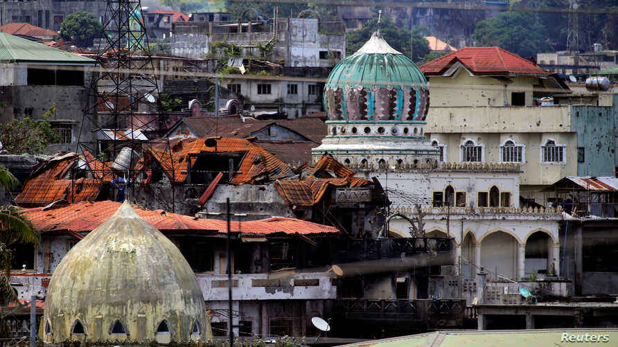 Damaged buildings and houses are seen as government forces continue their assault against insurgents from the Maute group, who have taken over large parts of the Marawi City, Philippines, June 22, 2017.