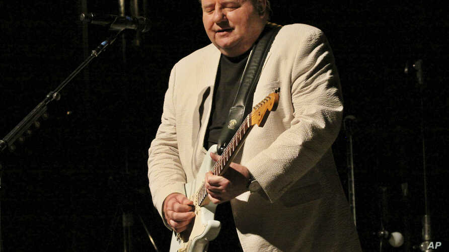 Greg Lake, singer, songwriter and bassist for legendary British rock bands King Crimson and Emerson, Lake and Palmer, performs at the Variety Playhouse in Atlanta, April 26, 2012. Lake died Dec. 7, 2016 at age 69.
