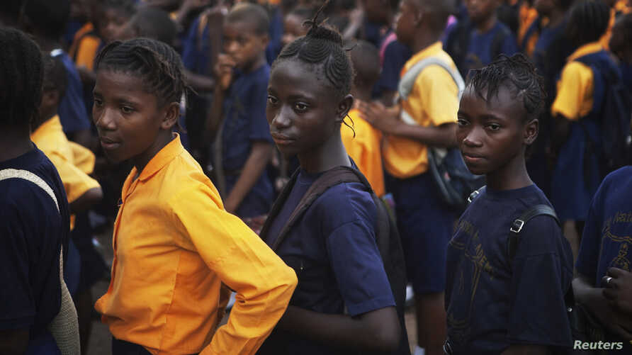 FILE - Students arrive for class at the Every Nation Academy private school in the city of Makeni in Sierra Leone.