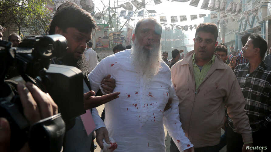 Salahuddin Ahmed, a Bangladesh Nationalist Party (BNP) candidate for general election, is seen bleeding as he was stabbed on a election day in Dhaka, Dec. 30, 2018.