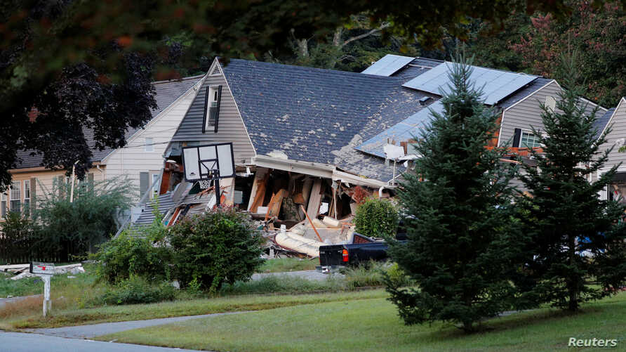 A home sits collapsed where a man died during a series of gas explosions in Lawrence, Mass., Sept. 14, 2018.