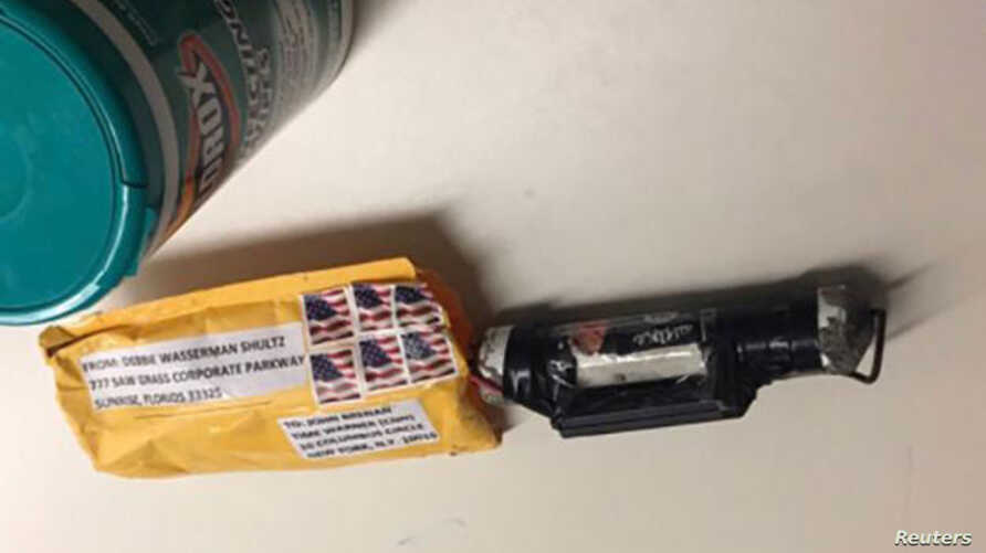 "A package containing a ""live explosive device,"" according to police, received at the Time Warner Center, which houses the CNN New York bureau, is shown in this handout picture provided Oct. 24, 2018."