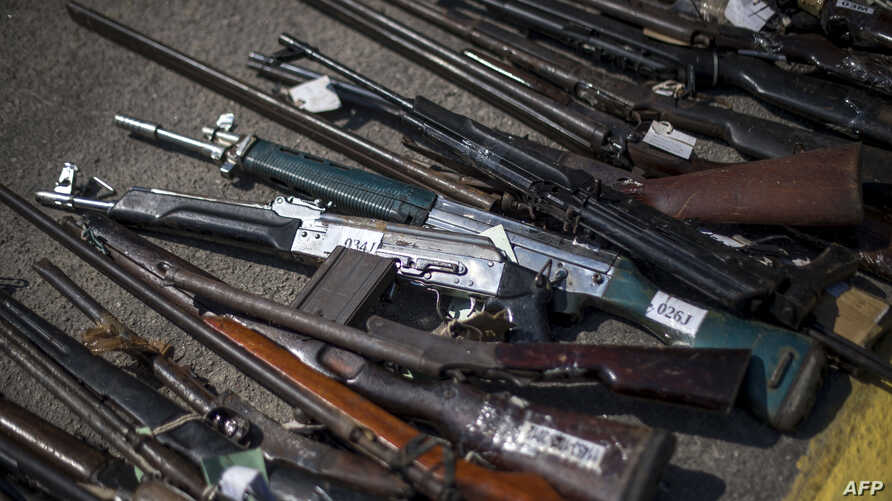 Picture of guns seized by police forces during various criminal investigations over the last ten years, taken before being destroyed at a military base in Deodoro in Rio de Janeiro on Dec. 20, 2017.