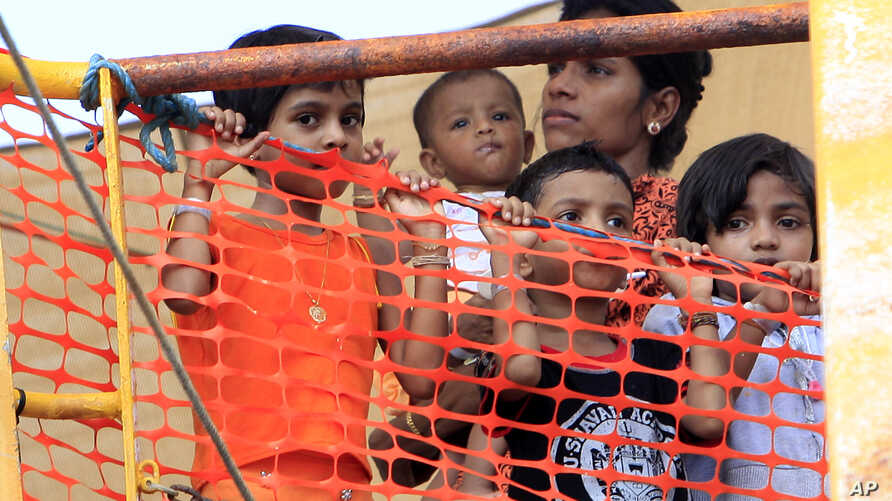 FILE - Sri Lankan refugees are seen onboard the Oceanic Viking, an Australian Customs and Fishery Patrol vessel about 14 kilometers out at sea from Kijang, Tanjung Pinang on the Indonesian Island of Bintan.