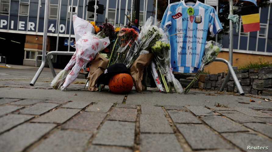 An Argentinian national team jersey hangs at a memorial on West Street two days after a man driving a rented pickup truck mowed down pedestrians and cyclists on a bike path alongside the Hudson River, in New York, Nov. 2, 2017.