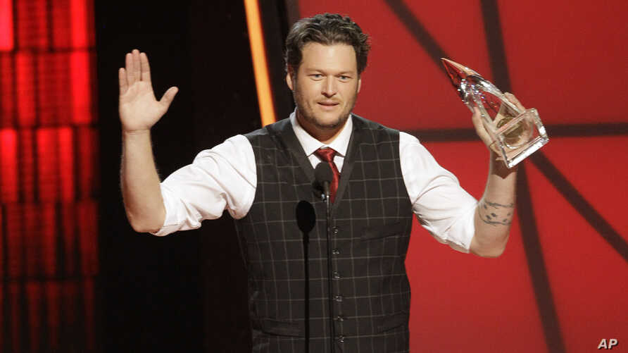 Blake Shelton accepts the award for entertainer of the year at the 46th Annual Country Music Awards at the Bridgestone Arena on  Nov. 1, 2012, in Nashville, Tenn.