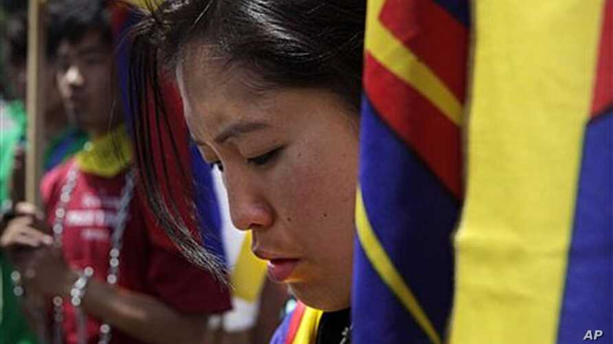 Tibetan students pray outside Rajghat, the memorial of Mahatma Gandhi, during a march demanding immediate withdrawal of Chinese troops from Kirti Monastery in Tibet, in New Delhi, India, April 19, 2011