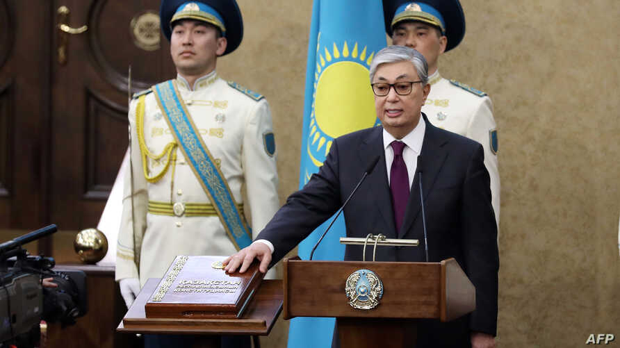 Kazakhstan's Senate chairman Kassym-Jomart Tokayev takes the oath as Kazakh interim president during a ceremony in Astana, March 20, 2019.