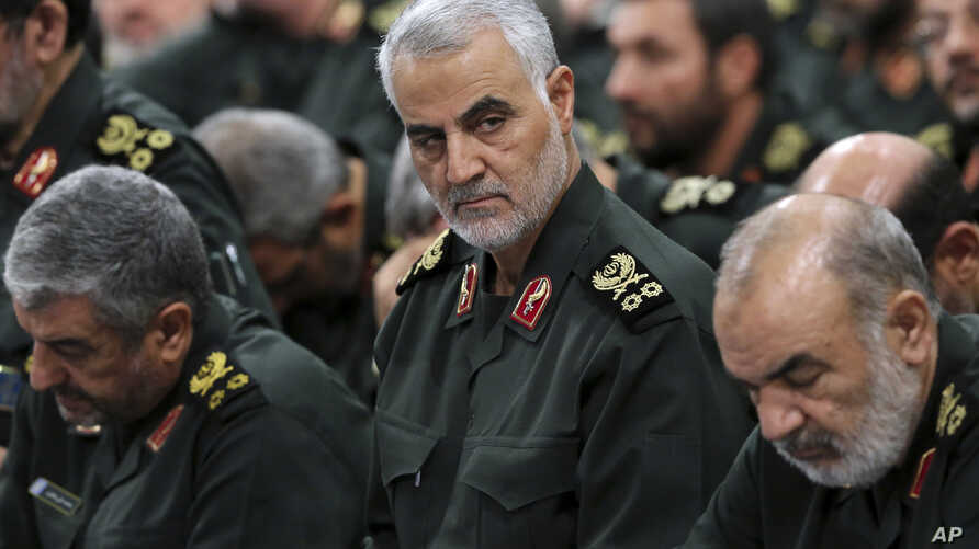 FILE - In this Sept. 18, 2016, photo released by an official website of the office of the Iranian supreme leader, Revolutionary Guard Gen. Qassem Soleimani, center, attends a meeting with Supreme Leader Ayatollah Ali Khamenei and Revolutionary Guard ...