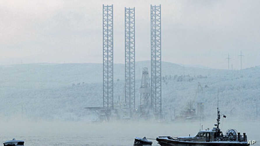 """The """"Kolskaya"""" oil drilling rig is pictured in the Kola Bay near Russia's northern seaport of Murmansk. The oil drilling rig with 67 crew on board capsized and sank off the Russian Far East island of Sakhalin when it ran into a storm while being towe"""