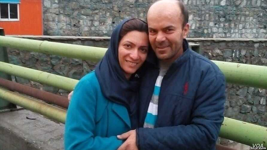 Neda Shabani, an Iranian Baha'i resident of the northern city of Karaj, embraces her husband outside of an Iranian prison after being released on bail Jan. 28, 2019, in this photo sent to VOA Persian by an Iranian Baha'i community member.