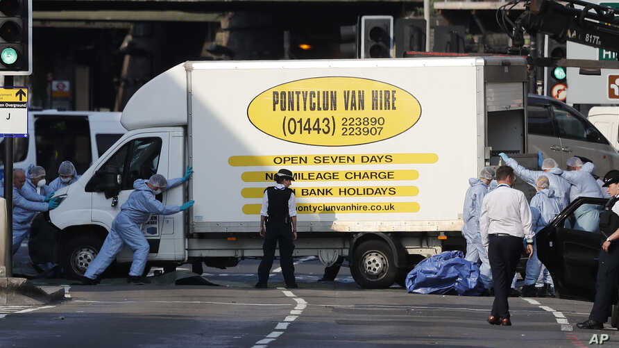 Forensic officers move the van at Finsbury Park in north London, where a vehicle struck pedestrians in north London, June 19, 2017.