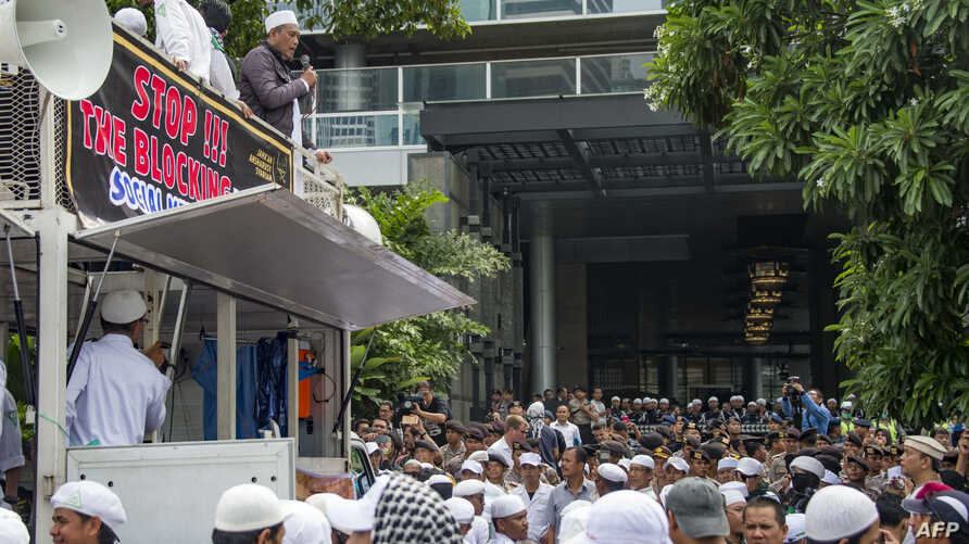 Members of a hard-line Muslim group gather for a demonstration outside the Facebook office building in Jakarta, Jan. 12, 2018.