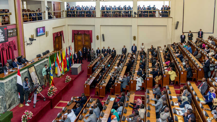 Egyptian President Abdel-Fattah el-Sissi, middle, on the far left table seated, addresses the Ethiopian parliament Wednesday, March 25, 2015,  in Addis Ababa Ethiopia.