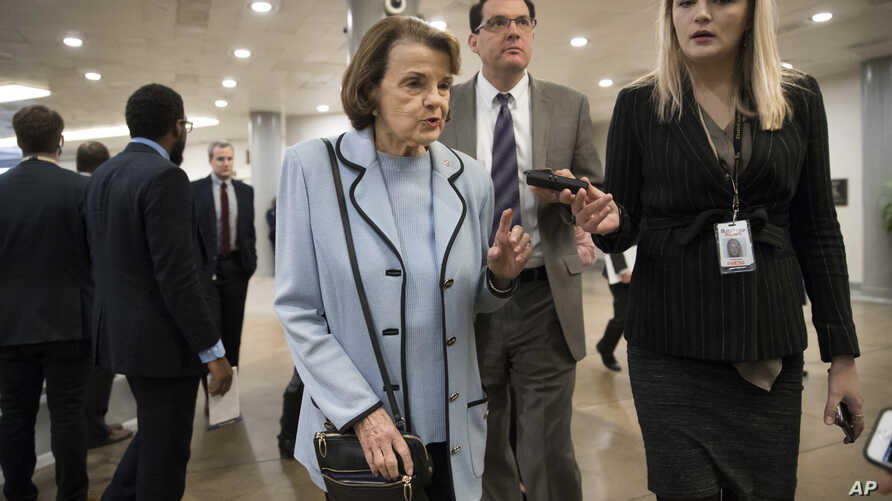 Sen. Dianne Feinstein, D-Calif., the ranking member on the Senate Judiciary Committee, takes a reporter's question as she walks to the Senate for a vote, at the Capitol in Washington, Jan. 11, 2018.
