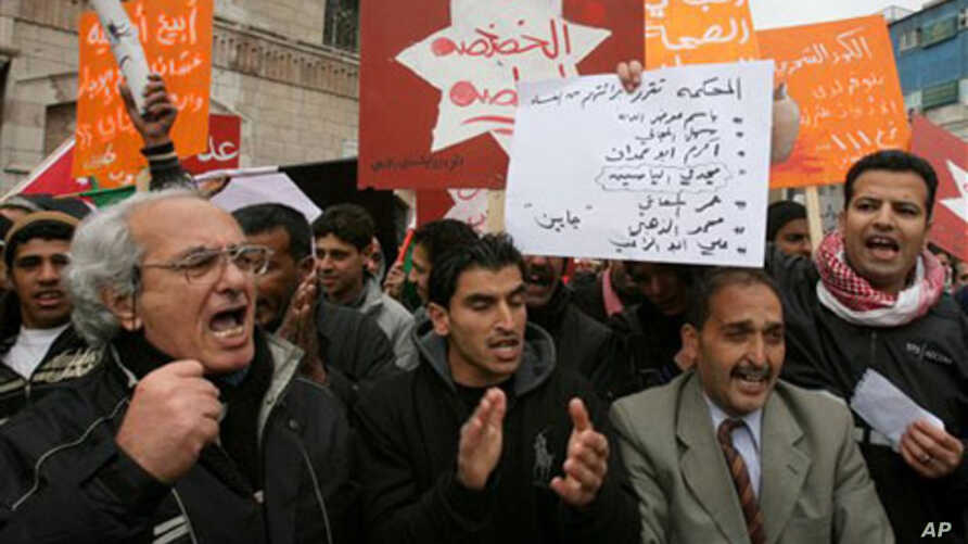 Jordanian protesters shout slogans during a protest following Friday prayers in Amman, March, 11, 2011
